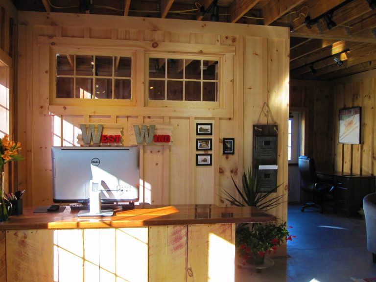 West Wind Realty office interior with exposed beams